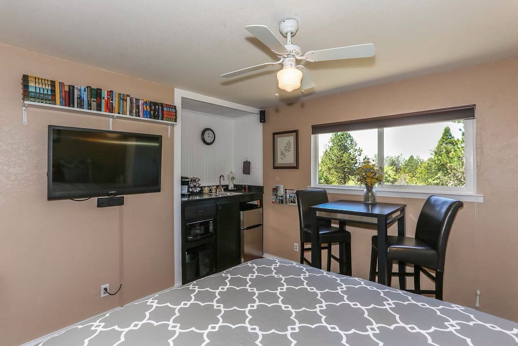 """The 42"""" flatscreen TV/DVD with surround sound also rotates toward the dining area."""