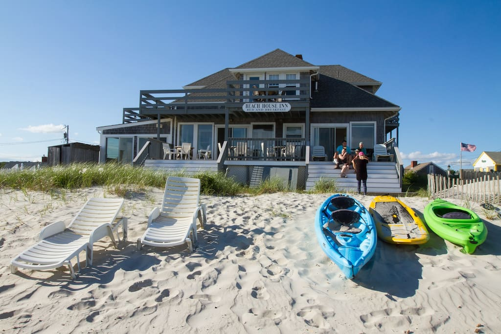 View of the house from the ocean - sugar soft sand - kayaks and paddle boards for our guest's use