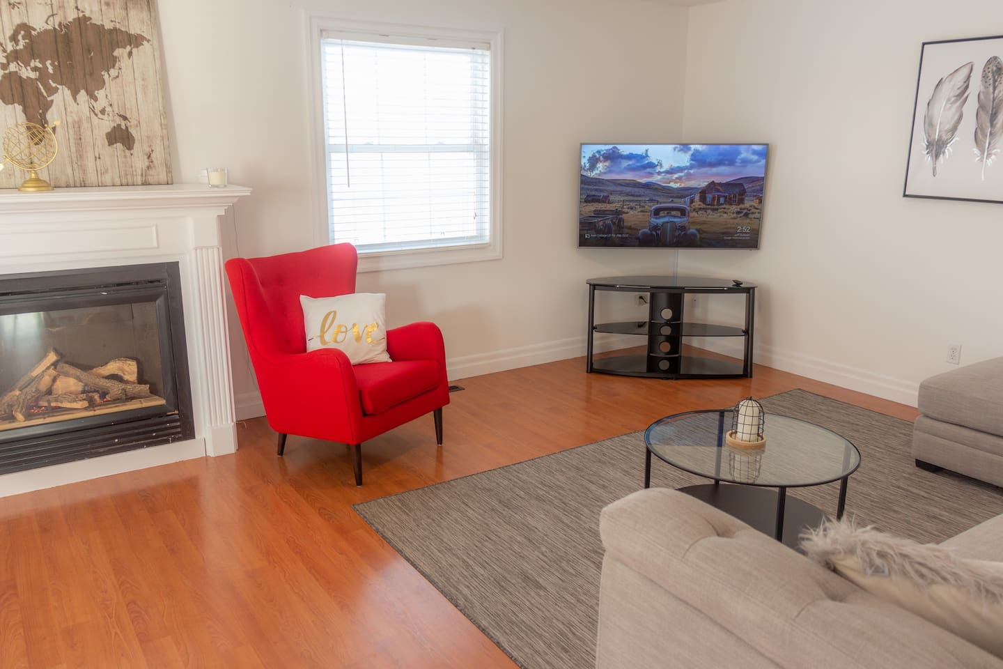 "Spacious and stylish living room and 55"" TV and fireplace"