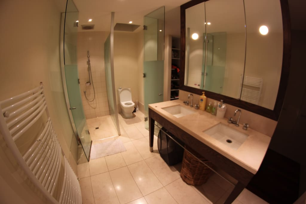 Spacious private ensuite bathroom with his and hers wash basins.