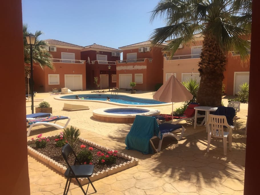 Pool area taken from downstairs patio. 4 sun loungers, patio furniture & beach\pool towels provided