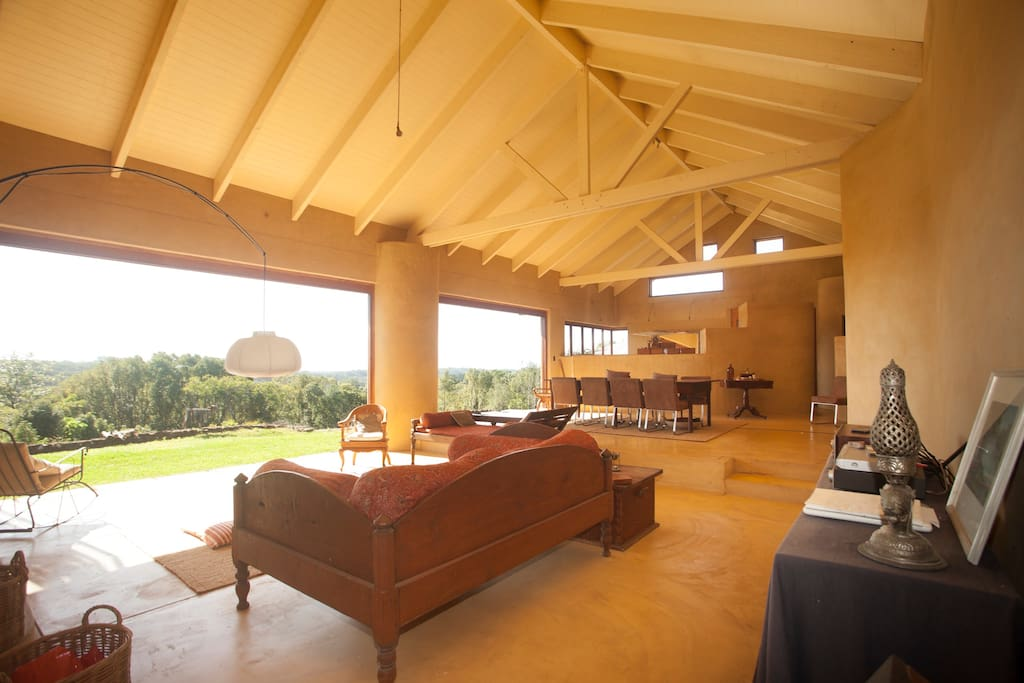 The main room with gourmet kitchen, dinning table for 10 and comfy day beds and views to the ocean and beyond.