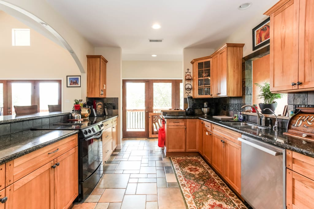 Spacious Fully Stocked Kitchen with Gas grill just outside