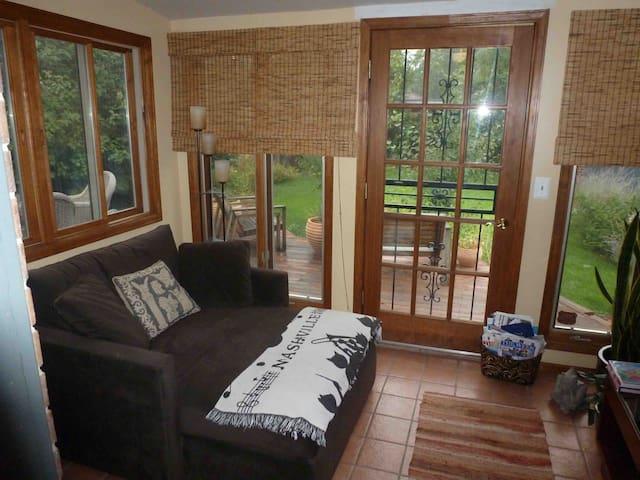 Sun room with TV (toward back deck).