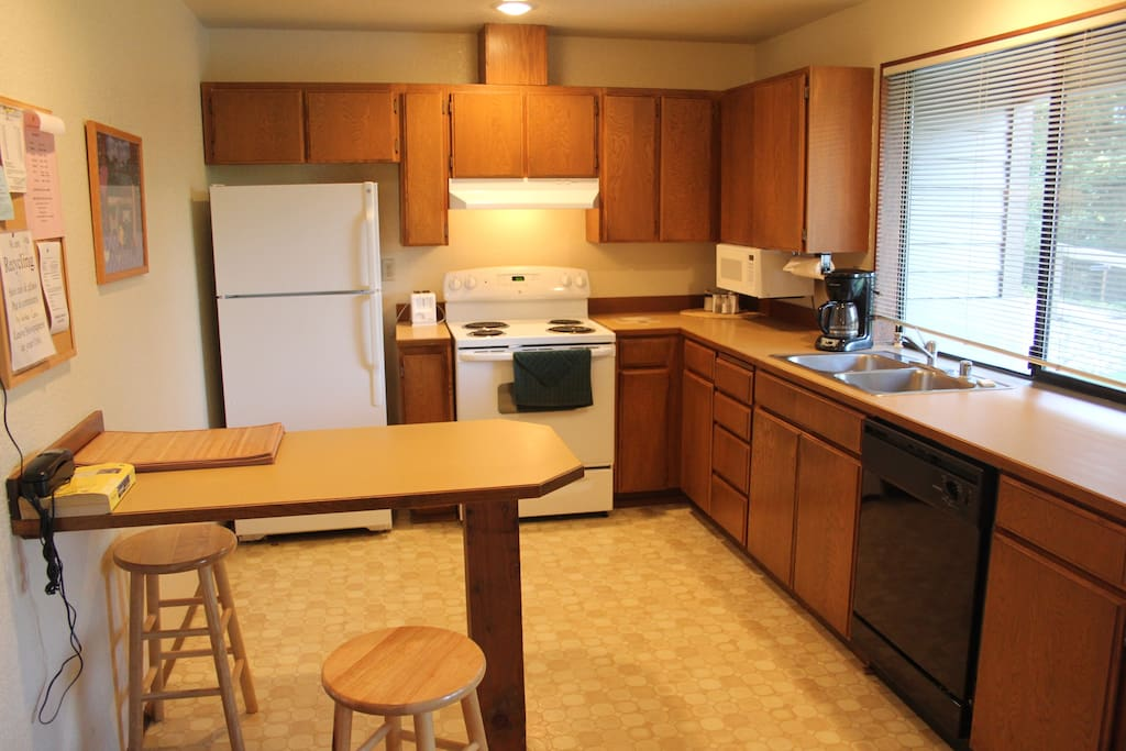 Kitchen with nice clean appliances.