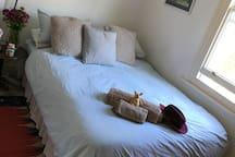 Bedroom comfy bed overlooks garden