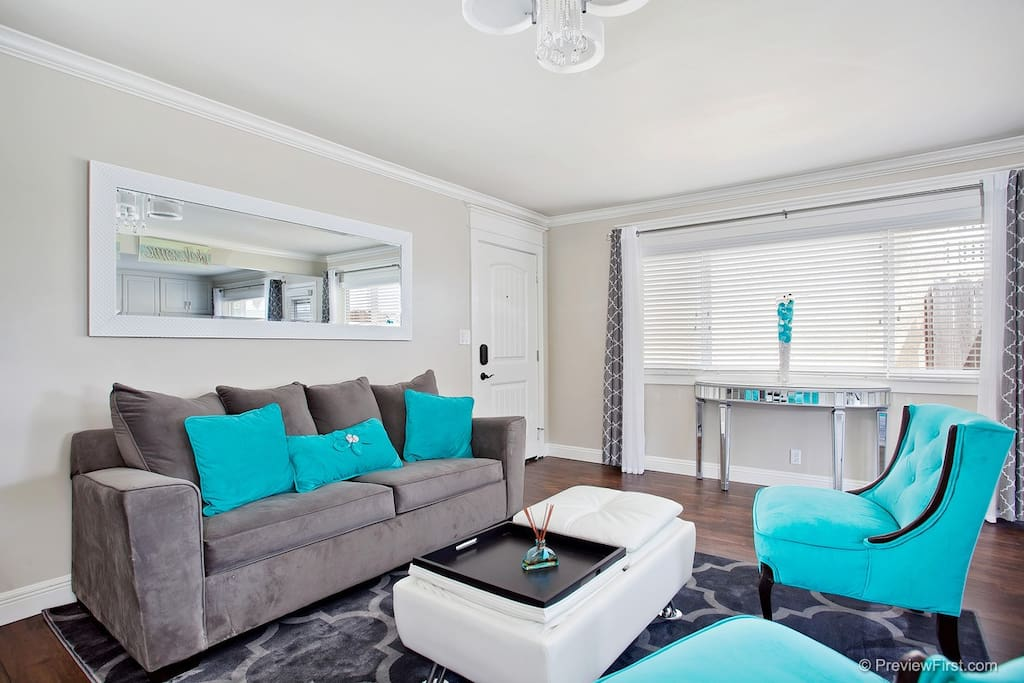 Main entrance opens up to an open-concept living area. Spacious, bright, & chic.