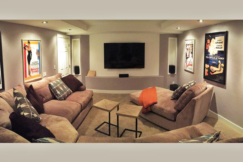 The entertainment room has a large 4K  ultra-high definition television