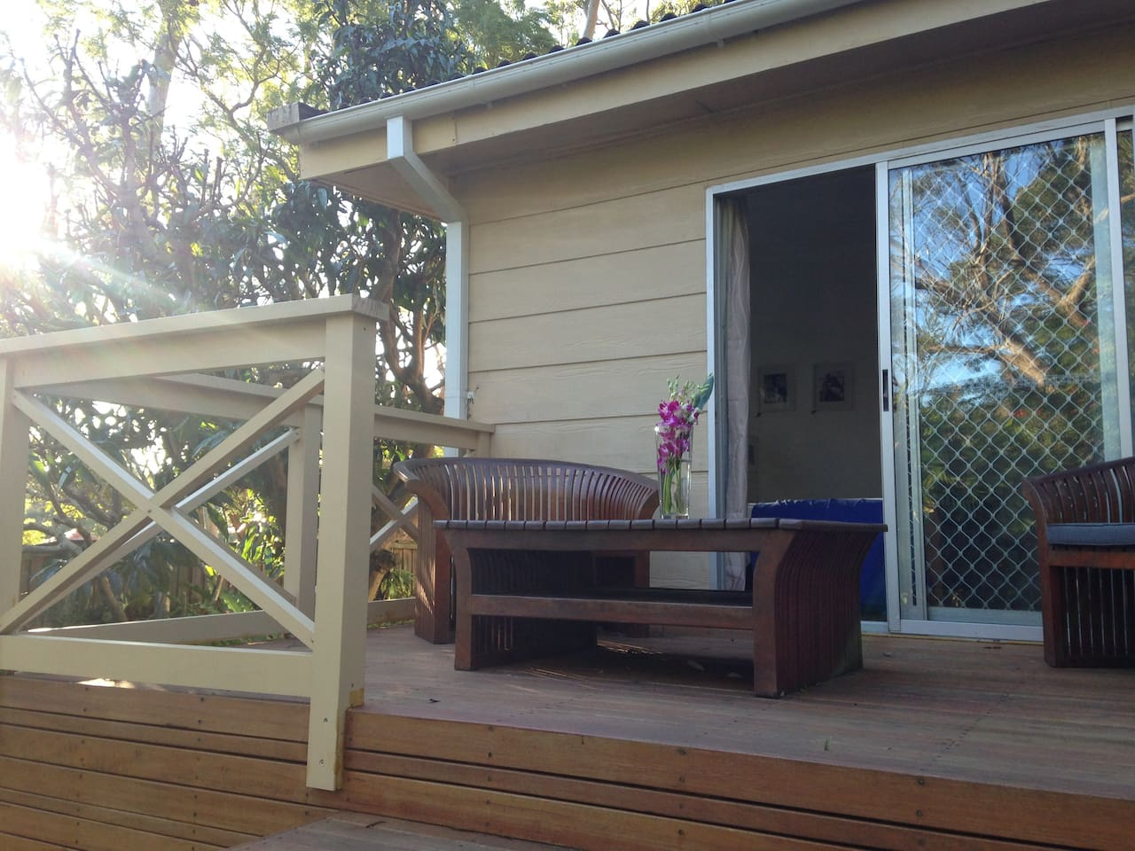 Serene back deck that opens up to the master bedroom. A lovely area to enjoy at any time of the year.