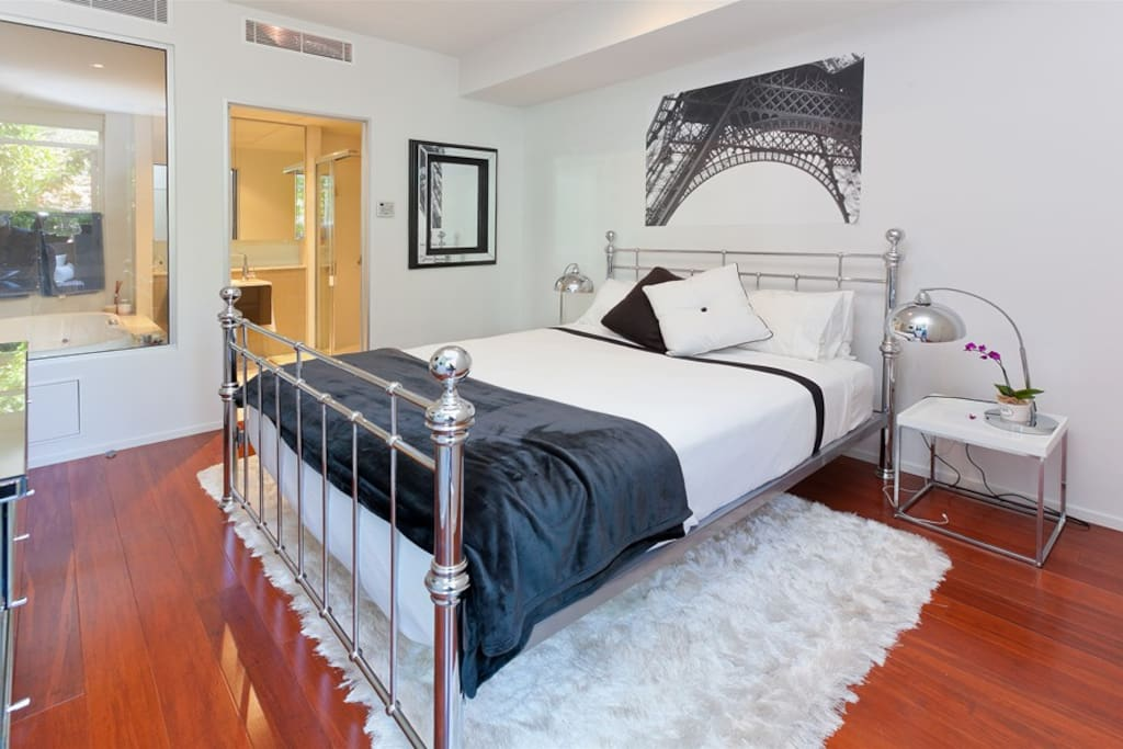 Master bedroom and ensuite, features a wall mounted TV with inbuilt DVD player