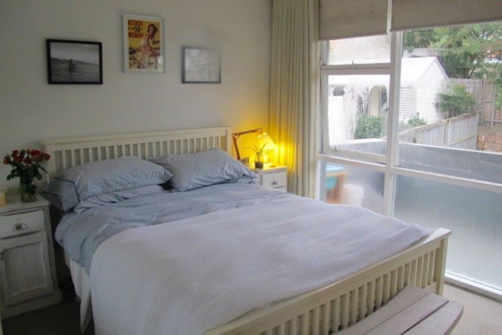 Main Bedroom opening out onto Large balcony with Ocean Views. Comfy Queen Size Bed