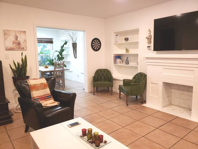 Living room with 5 leather arm chairs