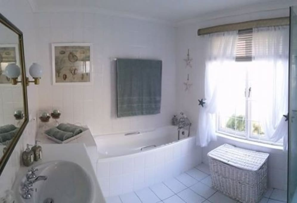 The main en-suite bathroom is fully fitted with a shower and bath.