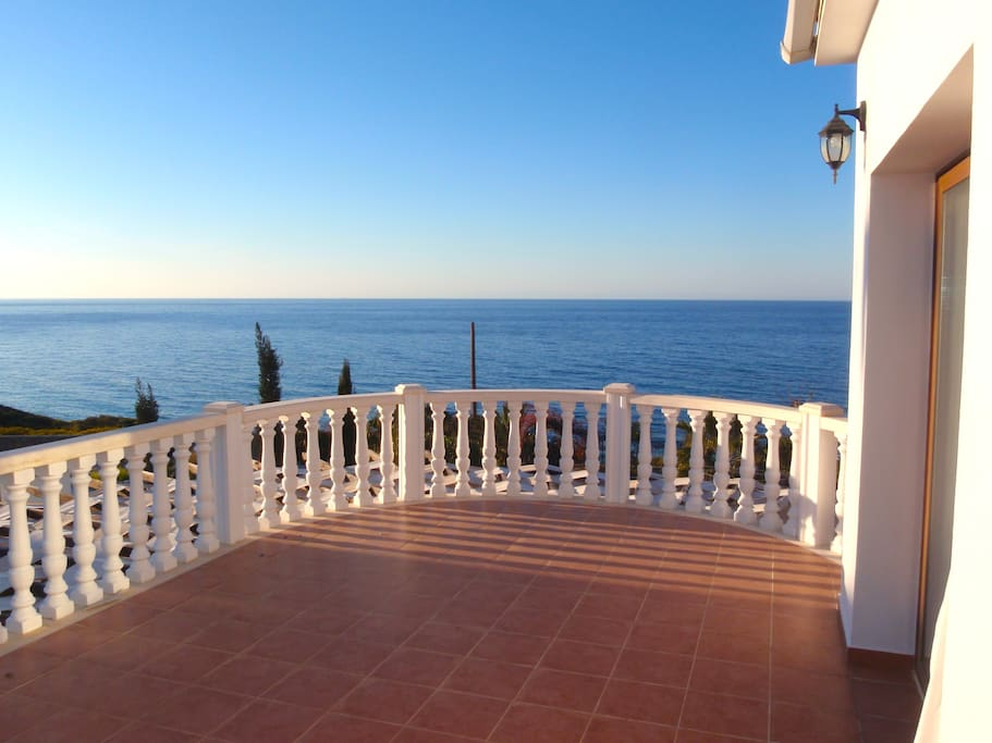 Extensive upper floor balcony with panoramic sea view.