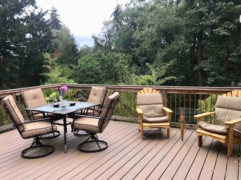 Spacious deck off the kitchen that is private.