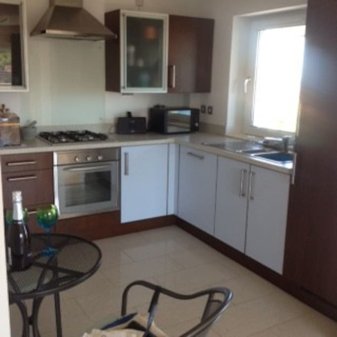Full fitted kitchen with integrated appliances.