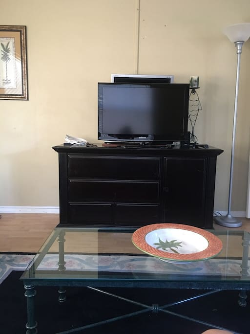 Entertainment center/extra dresser with flat screen tv cable box and dvd player.