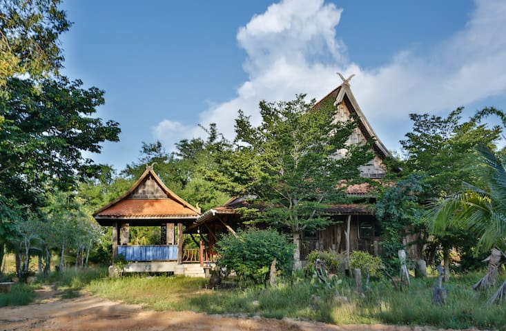 Traditional wooden Thai House with garden