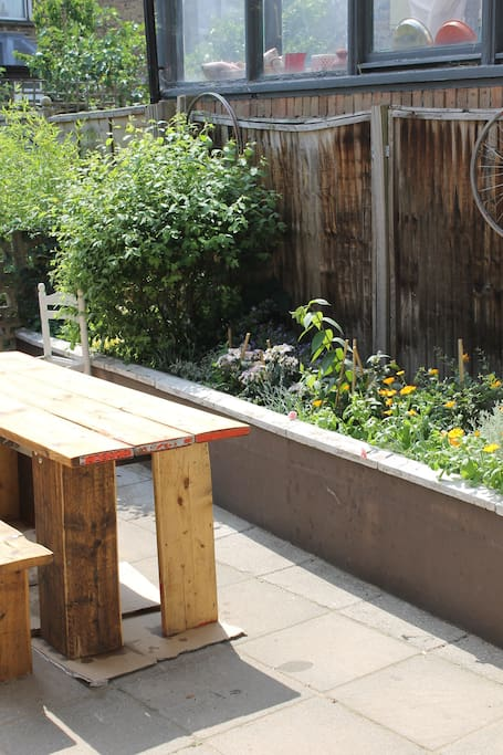 Patio in the sun in our south facing garden. This is an old picture, it's much bigger and better than this!