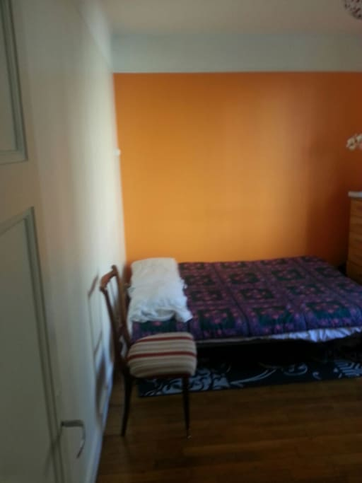 bed room with a window, a closet, table, 2 chairs, chest of drawers