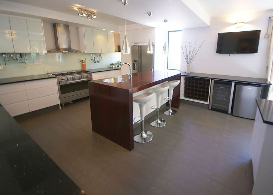 A beautiful, fully equipped modern kitchen with plenty of counter space for entertaining