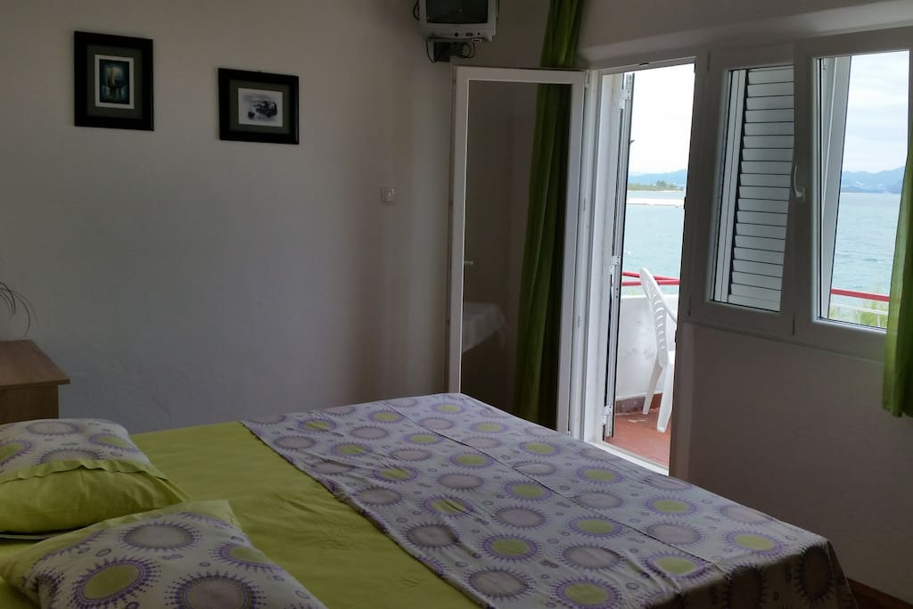 The first bedroom with two single beds 90x200 cm which can be separated or put together. Beautiful sea view from the balcony.