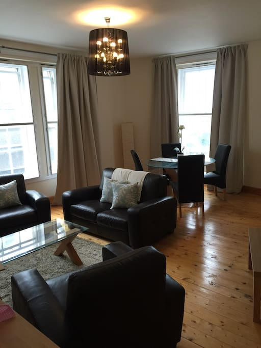 Livingroom with dining table. This room also has the foldaway bed for extra guests as agreed with landlord. Maximum occupancy is 6.