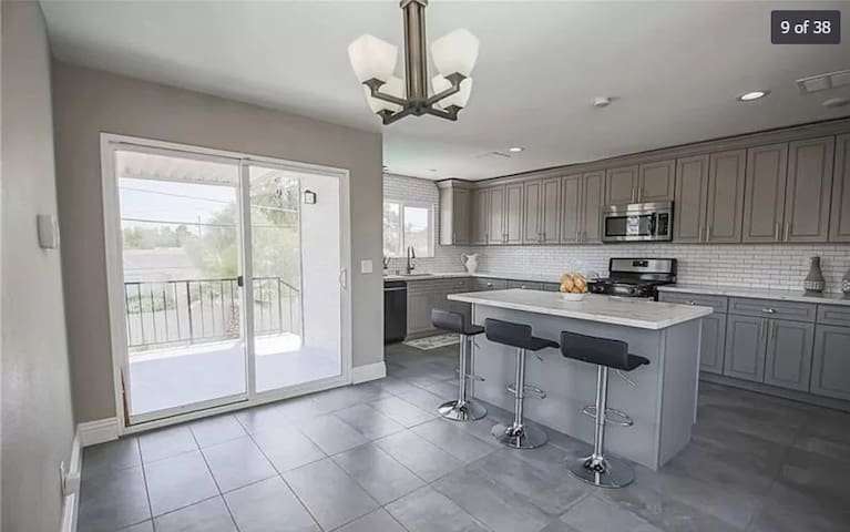 House with a pool walking distance from the Strip!