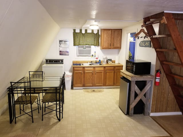 Kitchen includes dishes, mini fridge, microwave, coffee bar, hot plate and toaster oven!