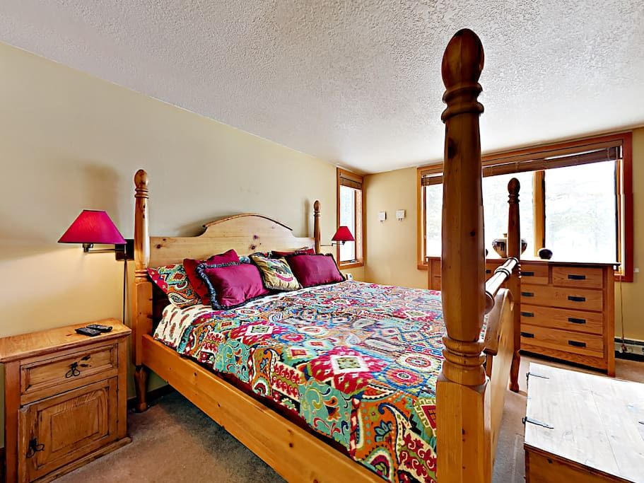 Sprawl out in a king-size bed in the master bedroom.