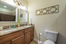 The Studio features a large, deluxe bathroom with a double sink vanity.