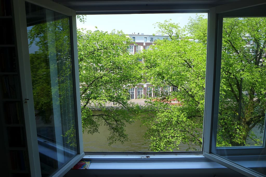 Kitchen, dining and living room are one large space with beautiful view on the canal