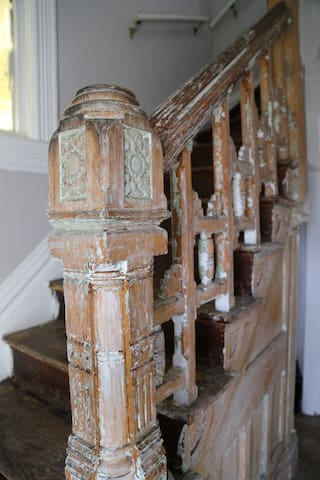 Reconditioning the old woodwork, removing years and layers of paint to revive.