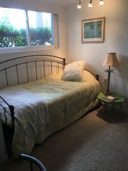 Bedroom, with additional mattress under bed, Desk and closet in the room.