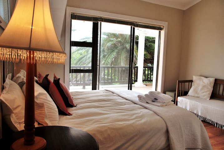 Second en-suite bedroom with with view over garden and swimming pool