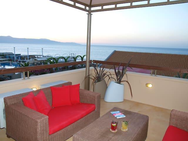 Seafront mansard apartment in Platanias