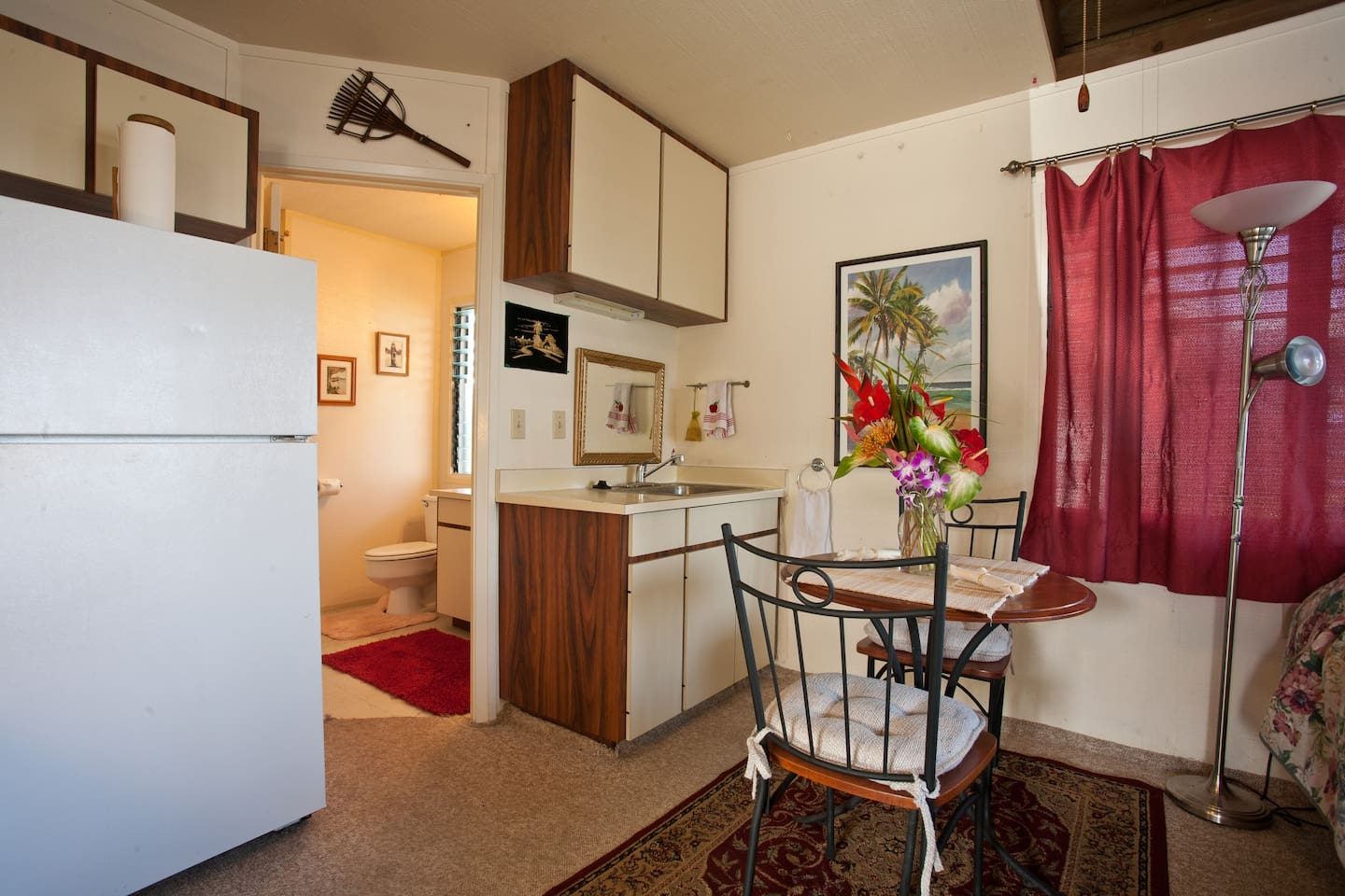 Shows kitchenette and full size refer and small bistro table. Most people eat outside on the private lanai