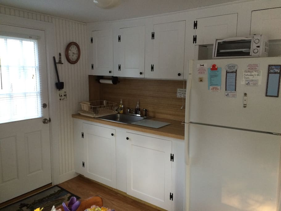 Kitchen with refrigerator, gas stove, toaster oven, microwave, coffee maker, blender and more...