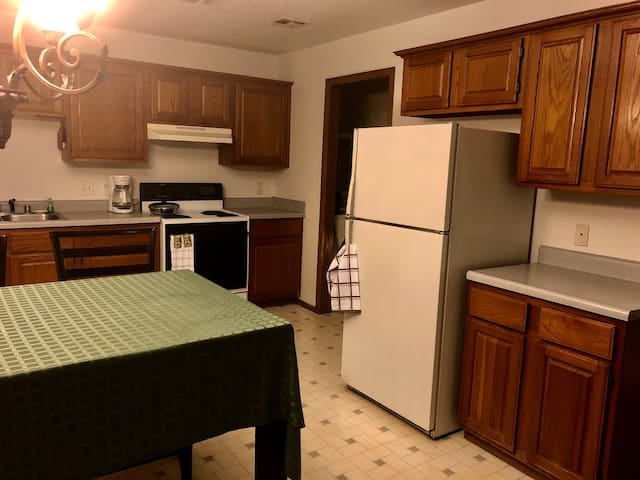 Refrigerator with ice maker Stove and oven and small laundry room with washer and dryer