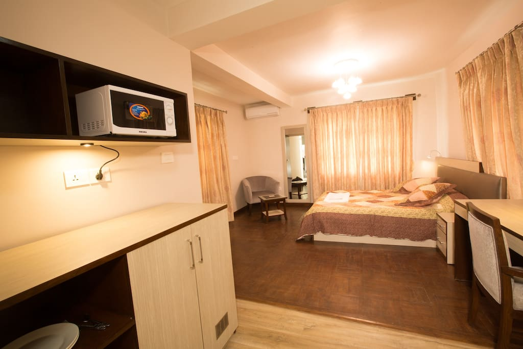 Each room is equipped with a microwave oven, kettle and fridge.