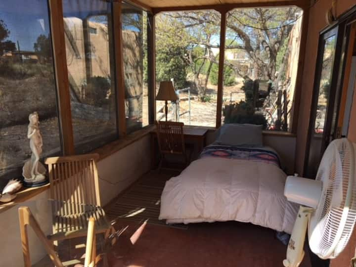 E.  Single bed in Sunroom