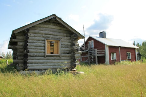 Traditional farmstead and cabins in Hossa