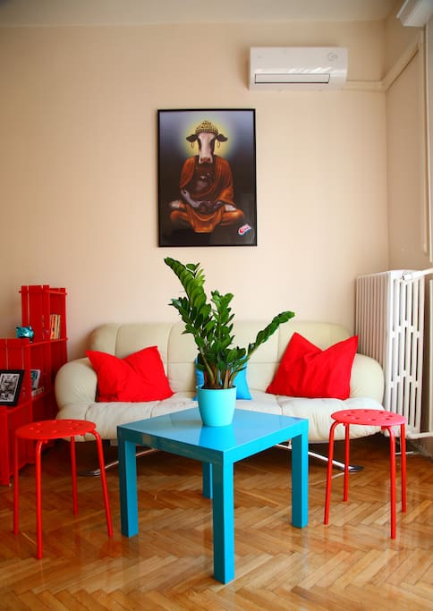 Living space area with a complimentary sofa bed, books, card & parlour games.