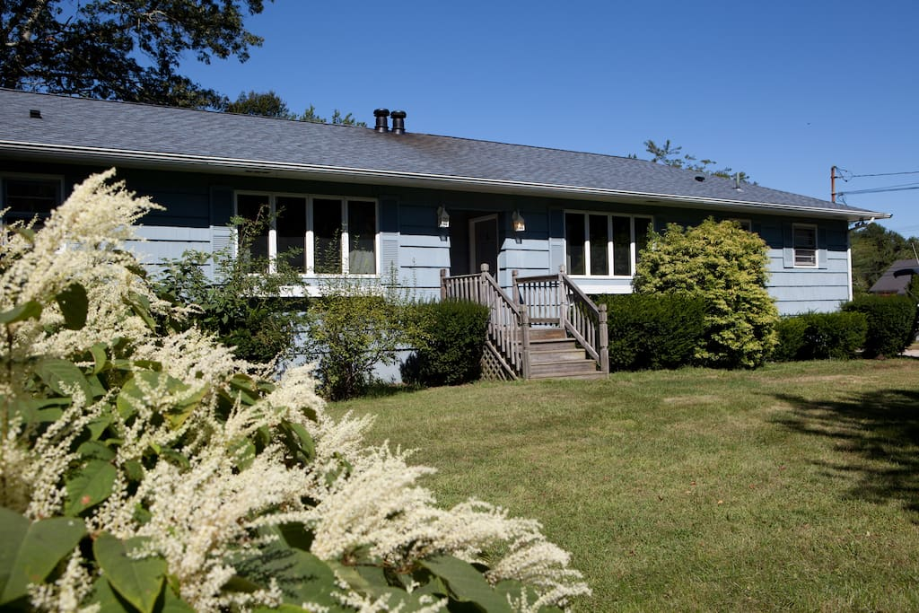 Idyllic vacation home located less than 1 mile from the beach on 2.5 acres of yard space.