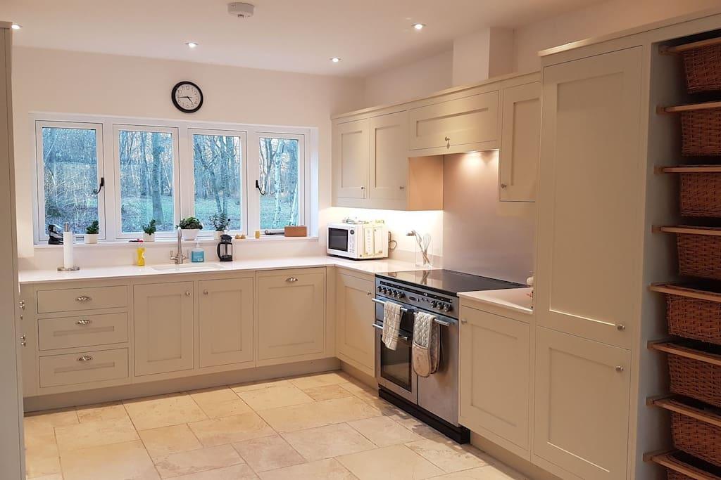 kitchen with dishwasher microwave fridge freezer. ect