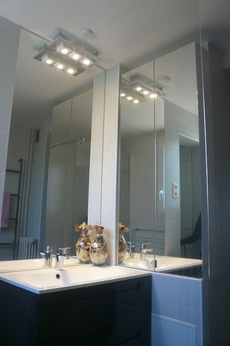 Bathroom. Shower stall (glass), flooring, mirrors, faucet, walls: everything is new. Very comfortable. Hidden is an Electrolux washing machine with multiple functions: silk, underwear, delicates, cotton, whites, etc.