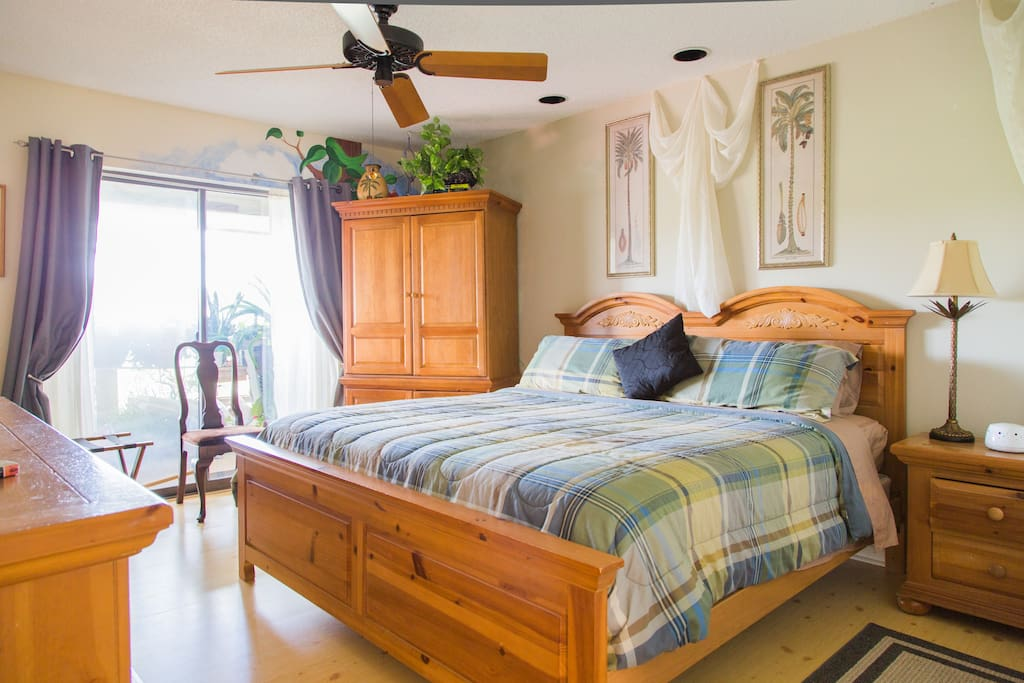 Bedroom is large, light and airy with a sliding glass door opening out to the large common area deck. The deck has two grills and table seating for 12.