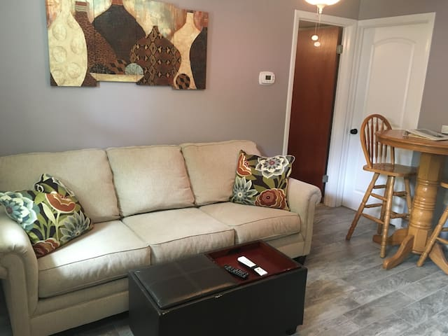 The living room and dining area are cozy and comfortable. The apartment does connect to the rest of our home through the white door, which will remain locked during your stay for complete privacy.