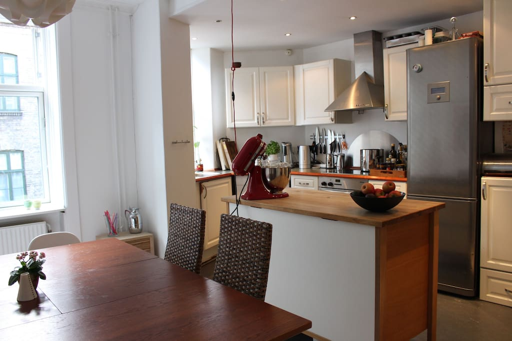 Fully equipped open kitchen with dinning area.