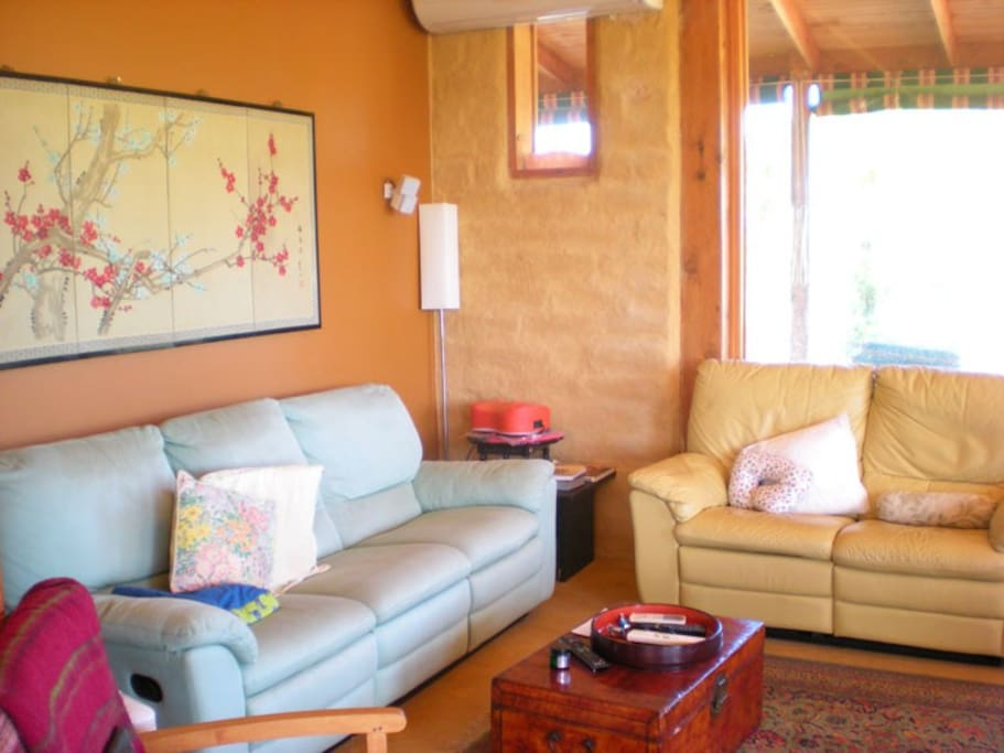 cosy living room, mud brick walls and earth colours